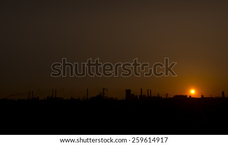 Sunset over the over the silhouette factory. ArcelorMittal Galati - stock photo