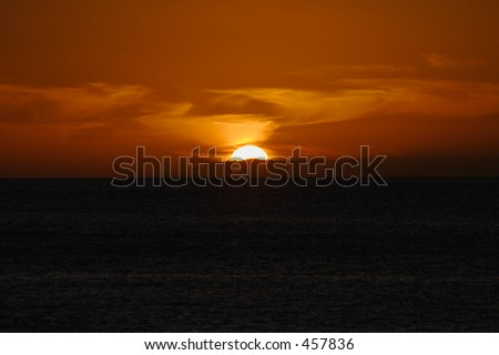 Sunset over the Pacific Ocean from Southwest Oahu. - stock photo