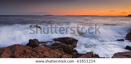 Sunset over the rocky coast line, otter cliff acadia national park - stock photo