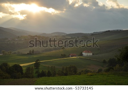 Sunset over the rolling hills - stock photo
