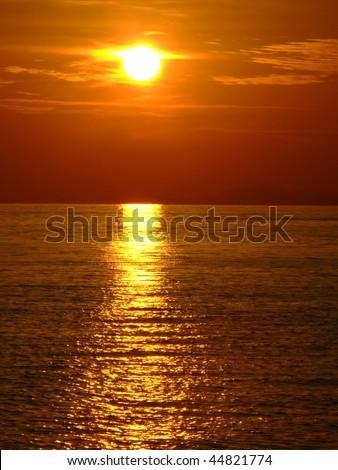 Sunset over the sea and beach, Koh Phangan, Thailand. - stock photo