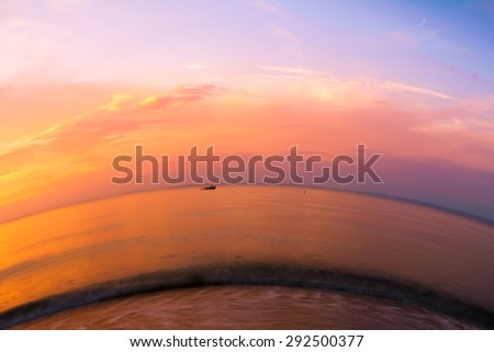 Sunset over the sea with fisheye effect - stock photo