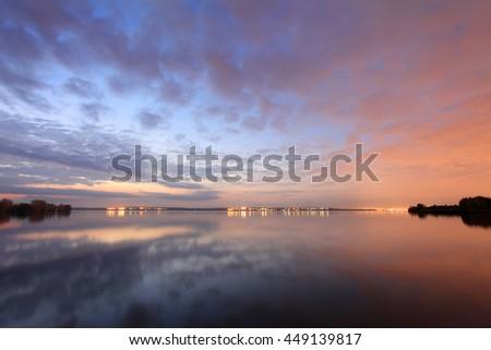 Sunset over the Shershnevskoe reservoir. Chelyabinsk, Russia. - stock photo