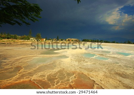 sunset over thermal water in Pamukkale Asia - stock photo