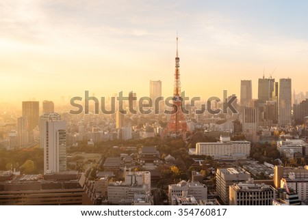Sunset over Tokyo. Tokyo  is both the capital and largest city of Japan. The Greater Tokyo Area is the most populous metropolitan area in the world. - stock photo