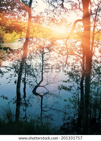 Sunset over water. Vertical panoramic landscape view. - stock photo