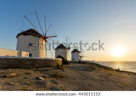 Sunset over White windmills on the island of Mykonos, Cyclades, Greece - stock photo