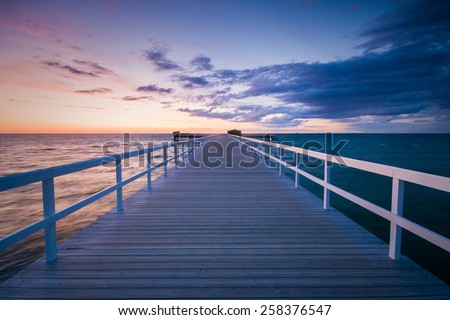 Sunset photo of a long pier in Malmoe, Sweden - stock photo
