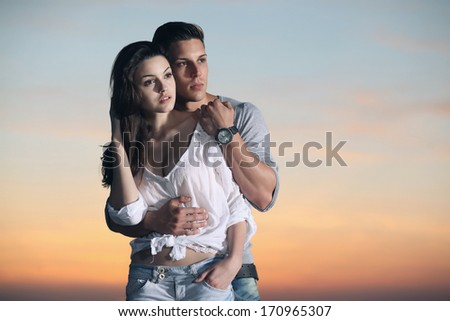 Sunset photo shoot with young attractive fashion models. - stock photo