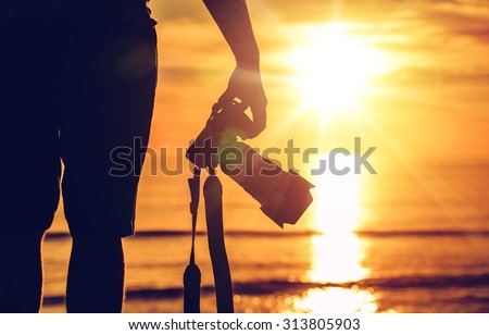 Sunset Photography. Photographer Ready to Take Sunset Pictures on the Beach. Professional Travel Photography Works. - stock photo