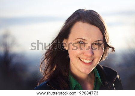 Sunset portrait of a pretty confident young woman - stock photo