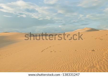 Sunset red dunes in Mui Ne, Vietnam. - stock photo
