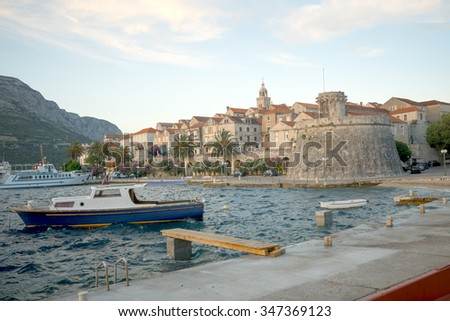 Sunset scene in the old town (west side), with the walls, houses, boats, in Korcula, Croatia - stock photo
