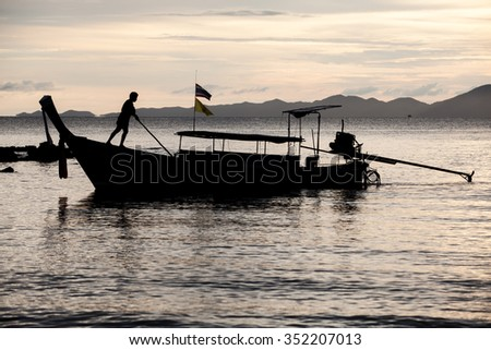 Sunset scene of traditional fisherman long tailed boat - stock photo