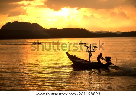 Sunset scene of traditional fisherman long tailed boat in Koh Phitak island, Southern of Thailand. - stock photo