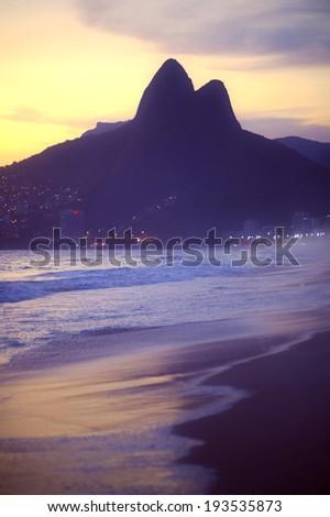 Sunset silhouette of Two Brothers Dois Irmaos Mountain Rio de Janeiro Ipanema Beach Brazil - stock photo