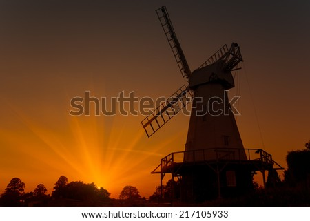 Sunset silhouette of Woodchurch windmill in Kent - stock photo