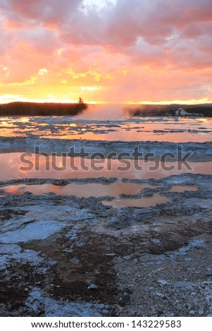 Sunset sky above a thermal pool in Yellowstone National Park, Wyoming, USA. - stock photo