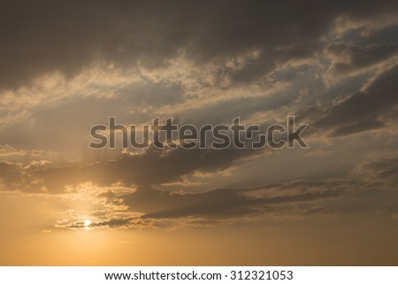 sunset sky background, light rays of sunbeam in evening - stock photo