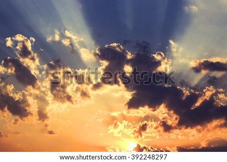 Sunset sky background with clouds and sun - stock photo