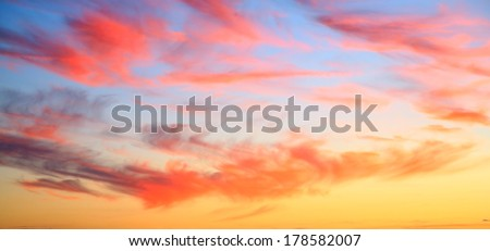 sunset sky only with pink clouds and orange and blue sky - stock photo