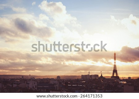 sunset sky over Paris, beautiful panoramic view with silhouette of Eiffel tower, warm colors - stock photo