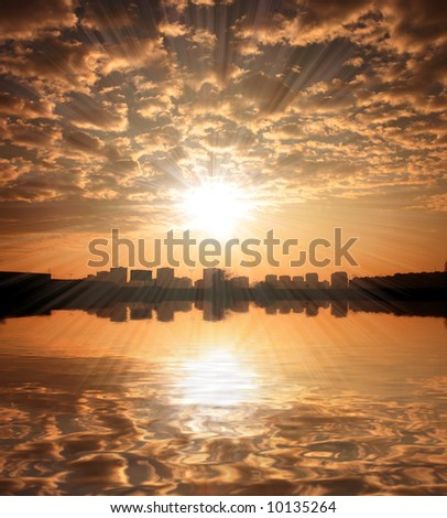 Sunset sky over Zagreb with reflection in river - stock photo