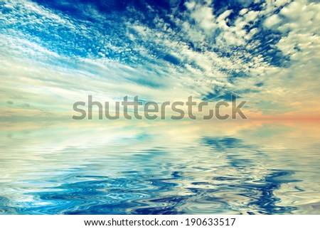 Sunset sky with beautiful clouds and sea. Vintage style - stock photo
