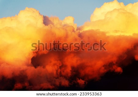 Sunset sky with dark clouds. - stock photo