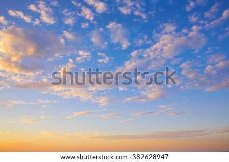 Sunset sky with golden and blue clouds in Mediterranean - stock photo