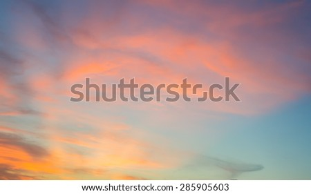 Sunset sky with orange colored clouds.  - stock photo