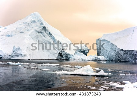 Sunset time at arctic ocean in Greenland - stock photo