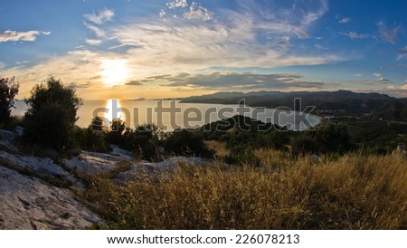 Sunset view at Toroni bay, aerial photo from the top of a hill, Sithonia, Greece - stock photo
