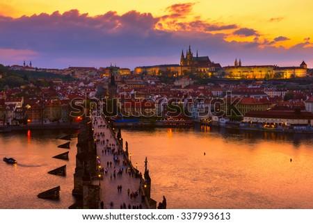 Sunset view of Charles Bridge(Karluv most), Prague Castle (Prazsky hrad) and Vltava river in Prague. Chech Republic - stock photo