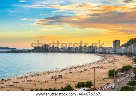 Sunset view of Copacabana beach and Avenida Atlantica in Rio de Janeiro, Brazil - stock photo