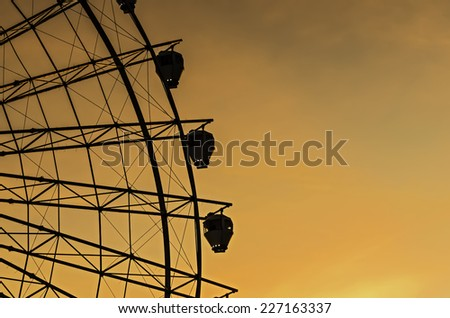 Sunset view of giant ferris wheel in the Philippines - stock photo
