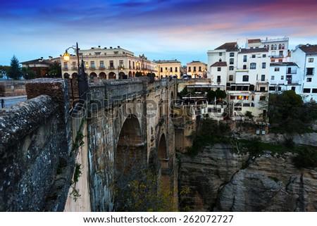 Sunset view of Ronda with Puente Nuevo bridge. Andalucia, Spain - stock photo