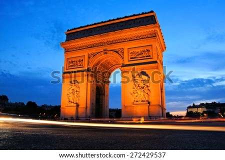 Sunset view of the Arc de Triomphe monument with beautiful blue sky, Paris, France - stock photo