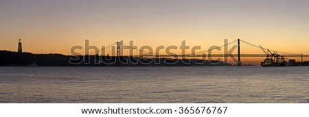 Sunset view of The 25 de Abril Bridge in Lisbon, Portugal, panorama