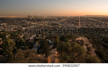 Sunset view of the downtown Los Angeles skyline at night, from Griffith Observatory, in Griffith Park, Los Angeles, California.  - stock photo