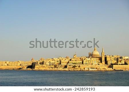 Sunset View of Valletta Skyline, from Sliema, Malta - stock photo