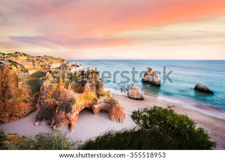 Sunset viewed from above Praia Dos Tres Irmaos near Portima - stock photo
