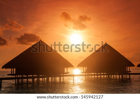 Sunset Villa Standing our into the Sea - stock photo