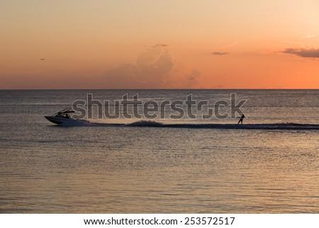 Sunset Water Skiing  - stock photo