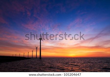 Sunset wind turbines - stock photo
