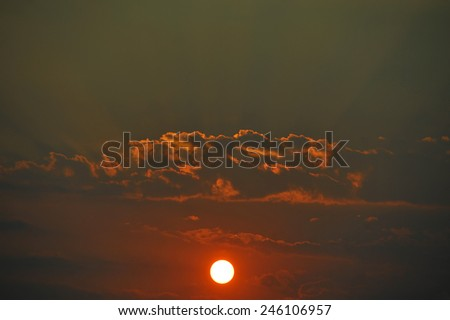 Sunset with amazing colour, sun ray and clouds  - stock photo