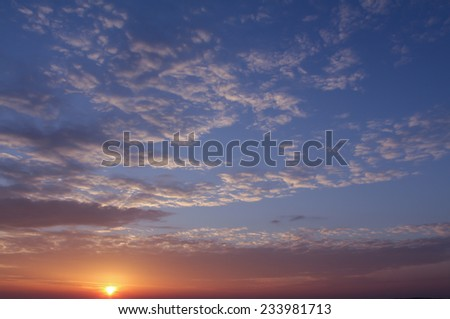 Sunset with clouds - stock photo