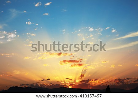 Sunset with clouds, light rays, blue sky, natural background. atmospheric effect - stock photo