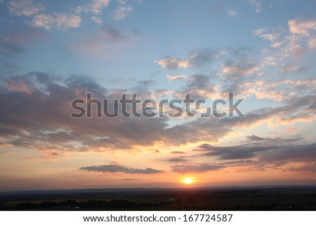Sunset with cloudy sky - stock photo