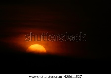 Sunset with dark clouds. - stock photo